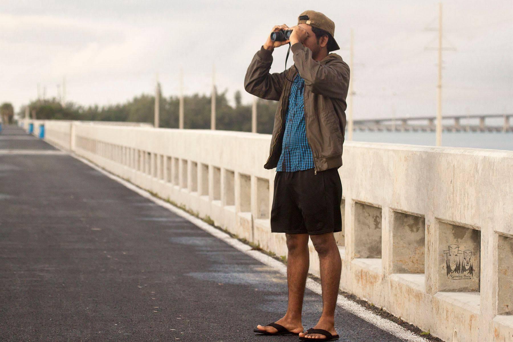 Vinod on bridge with binoculars, Florida Keys